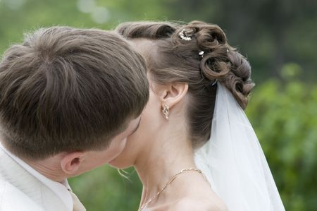 Young couple kissing. They are just married!