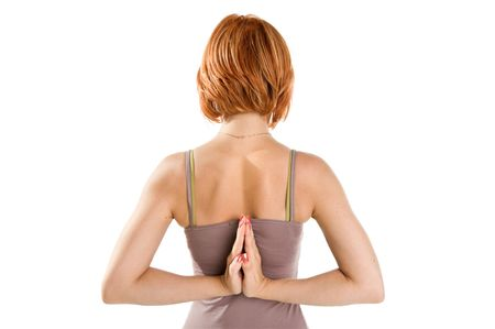 Red-haired girl practicing yoga isolated on white background