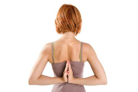 Roodharige meisje het beoefenen van yoga geïsoleerd op witte achtergrond Stockfoto