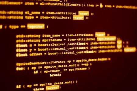 Computerbildschirm mit Programmcode in Hacker Farbe angezeigt. Standard-Bild