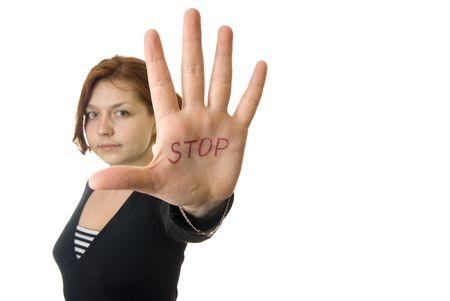 Chica mostrando Stop! gesto con su mano Foto de archivo