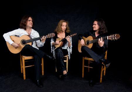 Three flamenco artists performing spanish national music