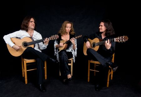 Three flamenco artists performing spanish national music