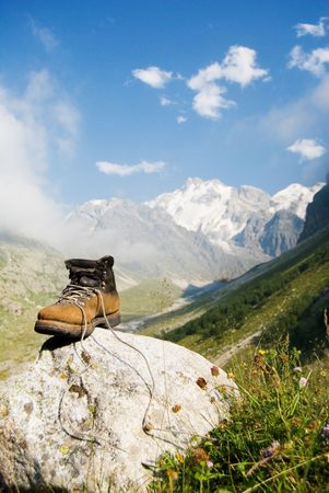 sturdy: Vintage climber boot is being dried in the base camp in Caucasian mountains Stock Photo