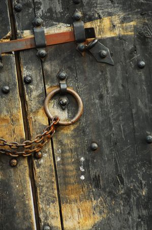 Heavy wooden doors with chains and padlocks are all about security photo