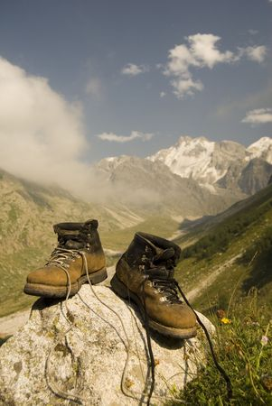 Vintage climber boots are dried in the base camp in mountains photo