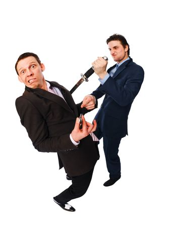 traitor: Two businessmen fighting isolated on white background