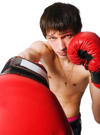 Handsome young man wearing boxing gloves isolated on white background photo