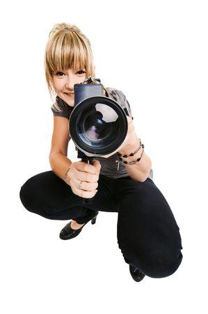 Mooie jonge foto graaf of video grap her op effen achtergrond Stockfoto