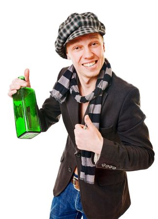 Young man with green bottle on white background photo