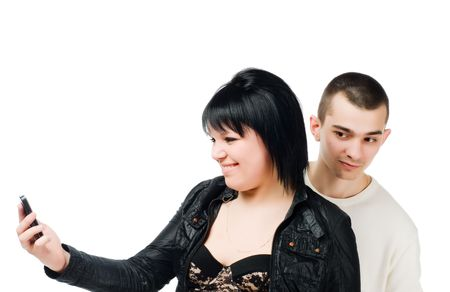 eavesdropping: Young woman with cell phone and guy eavesdropping on white Stock Photo
