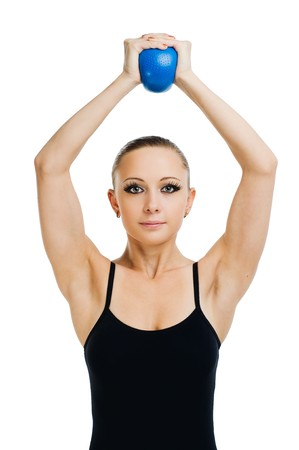 Beautiful fit red girl working out with blue ball photo