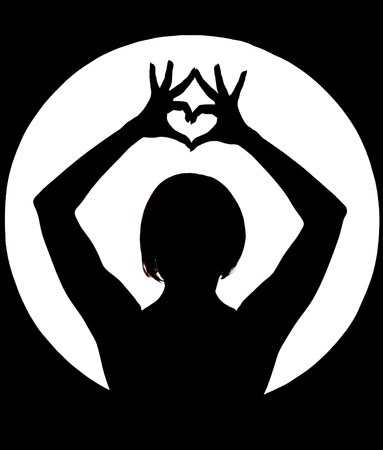 Silhouette of woman showing heart sign with her fingers Stock Photo