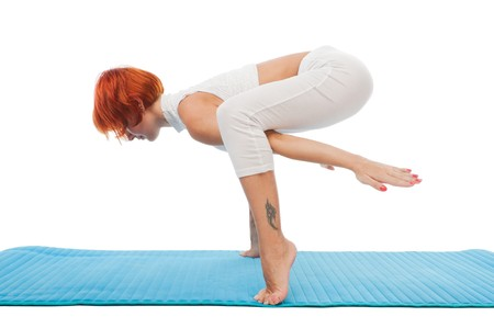 on tiptoes: Slim beautiful woman practicing yoga asana standing standing on tiptoes