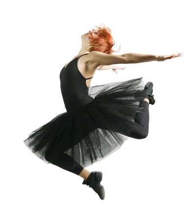 ballerina girl: Ballerina wearing black tutu jumping on white background Stock Photo
