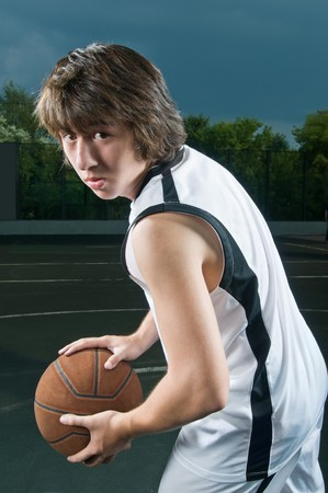 baller: Teenage basketball player holding the ball in triple threat position