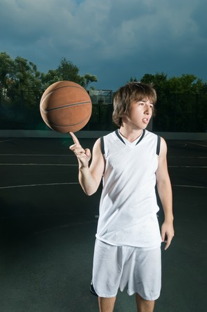 Streetball player showing his skills with the ball photo