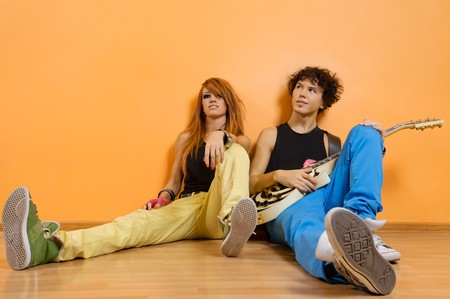 Two rock band members relaxing at the studio photo