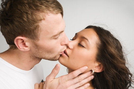 Young couple kissing and enjoy each other photo