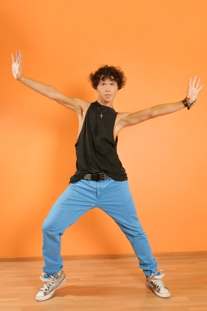 Young hip-hop performer posing on vivid background photo