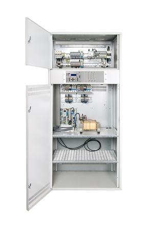 cupboard: Electrical enclosure with its door open. Could be electrical circuit breaker, fuse box, control panel, server or other electronics enclosure.