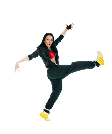 Cool hip-hop girl performing ultra move over white background photo