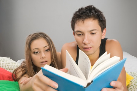 Young couple reading photo