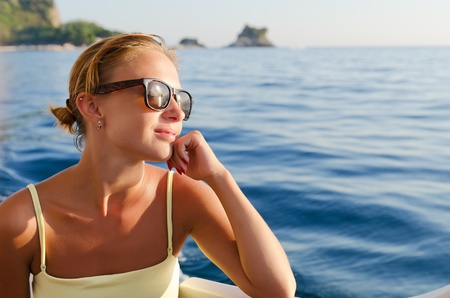 Red woman on a yacht cruise photo