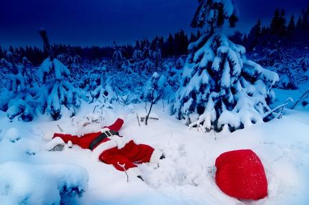 Santa fallen into snow photo