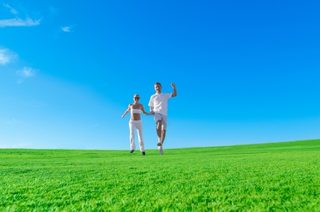 Happy excited couple jumping together photo