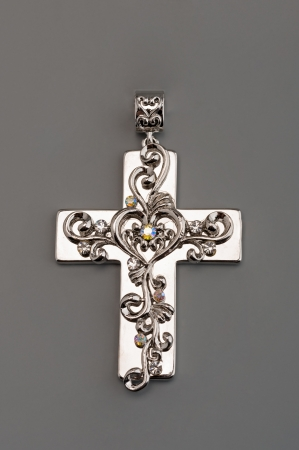 Silver cross on gray Stock Photo - 13638296