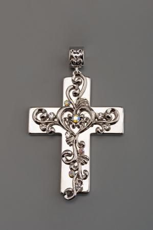 Silver cross on gray Stock Photo - 13638296