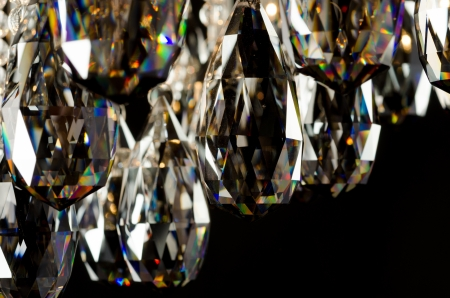 chandelier isolated: Contemporary glass chandelier crystals closeup