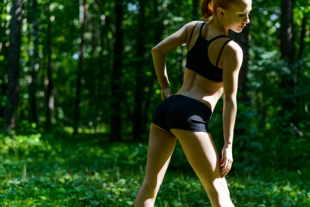 sensuous: Sensuous fitness woman in park Stock Photo