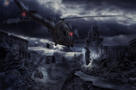war and military: Helicopter over ruined city during storm Stock Photo