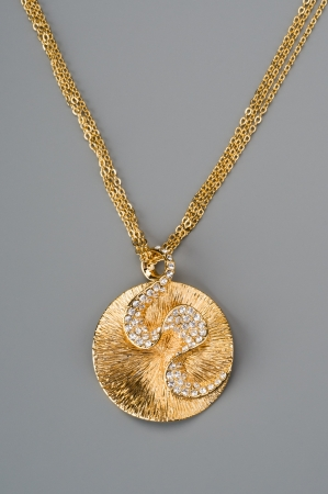 Golden pendant on a chain