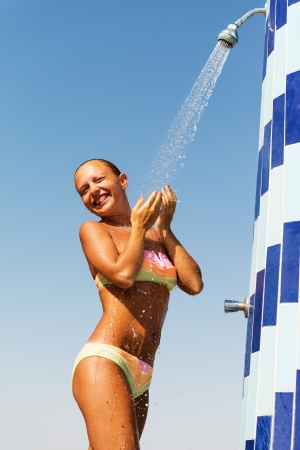 sensuous: Sensuous slim woman taking shower at the beach