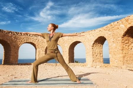Beautiful woman practicing yoga photo