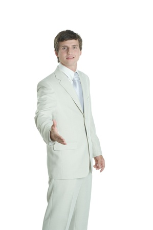 Young business man wearing white suit photo