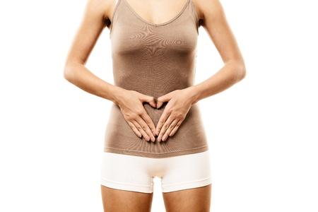 abdomen plano: Mujer con las manos en el vientre