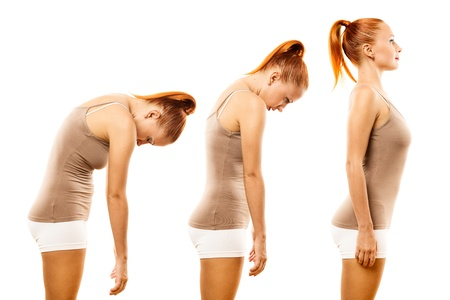 Young woman practicing yoga spine roll Standard-Bild