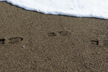 Footprint in the sand on a winter beach photo