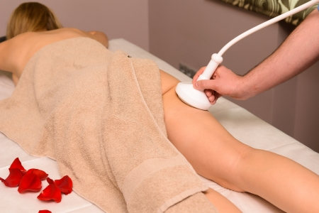 Woman gets therapy treatment at spa salon Stock Photo - 22117748