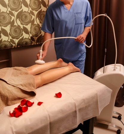 Woman gets therapy treatment at spa salon Stock Photo - 22117763