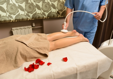 Woman gets therapy treatment at spa salon Stock Photo - 22117765