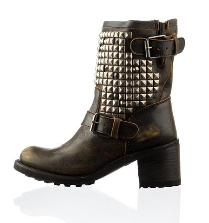 Fashionable stylish boot shoe on white background with reflection photo