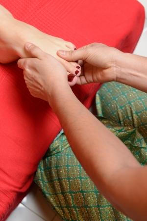 Young woman enjoying traditional thai foot massage Stock Photo - 22609507