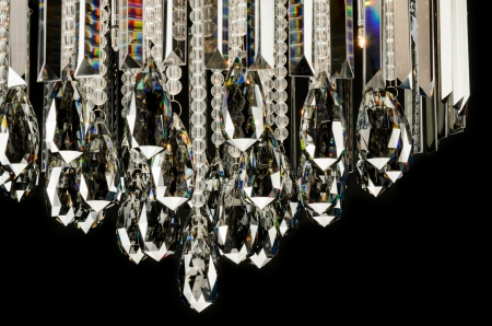 chandelier background: Contemporary glass chandelier fragment isolated over black background