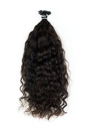 Extensions for dark curly hair isolated on a white background 版權商用圖片