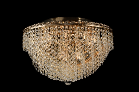 Contemporary glass chandelier isolated over black background photo